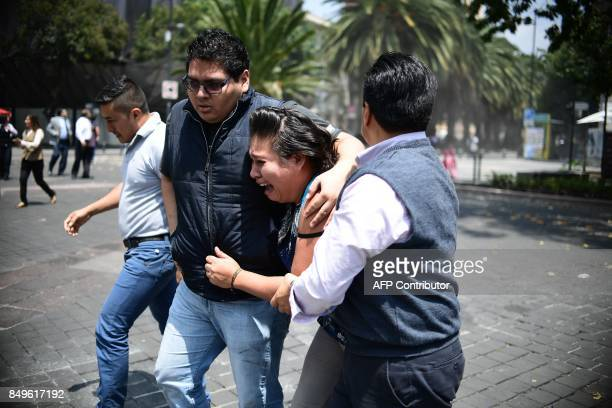 TOPSHOT People react as a real quake rattles Mexico City on September 19 2017 moments after an earthquake drill was held in the capital A 71...