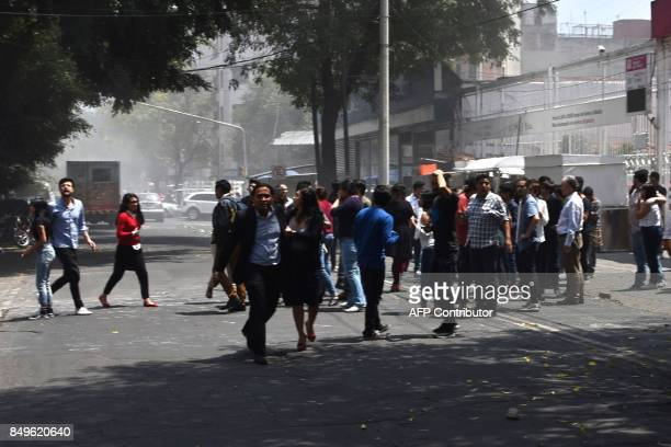 People react as a real quake rattles Mexico City on September 19 2017 moments after an earthquake drill was held in the capital A 71 magnitude...