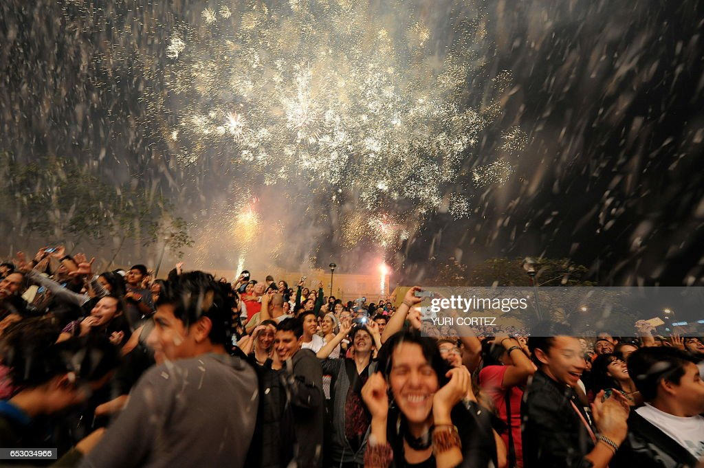 People react as actors of the German street theatre company Titanick perform during the play 'FireBirds' on March 28, 2010 at the Democracy Square in San Jose during the closing of the Internationa...