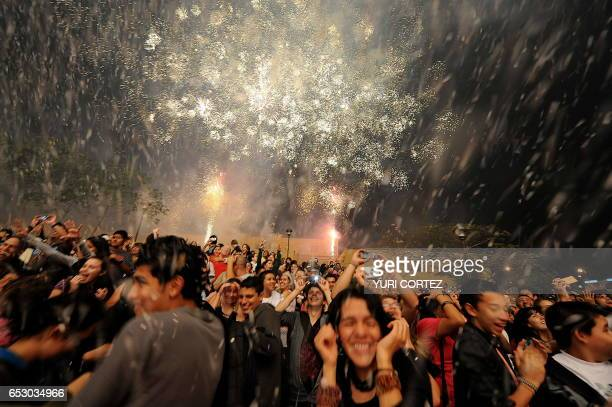 People react as actors of the German street theatre company Titanick perform during the play 'FireBirds' on March 28 2010 at the Democracy Square in...