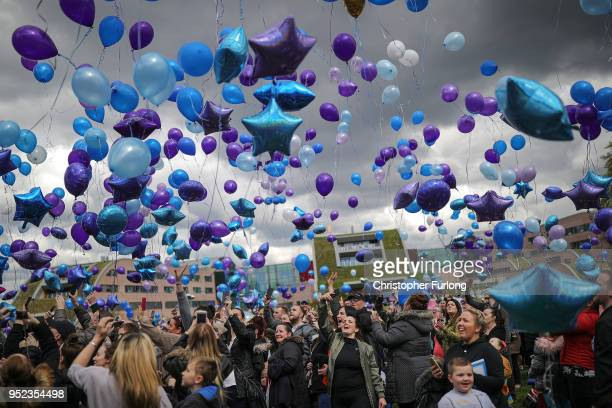 People react as balloons are released in memory of Alfie Evans outside Alder Hey Hospital after the terminally ill 23monthold died at 230am this...