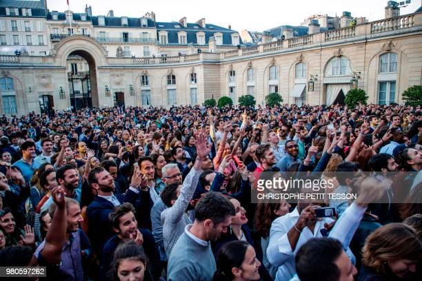 People react as Dj Kiddy Smile performs during the annual 'Fete de la Musique' in the courtyard of the Elysee Palace in Paris on June 21 2018