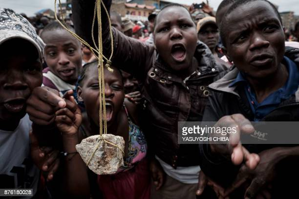 People react as Kenya's opposition party National Super Alliance leader arriving at Riverside slum in Nairobi on November 19 2017 Four bodies were...