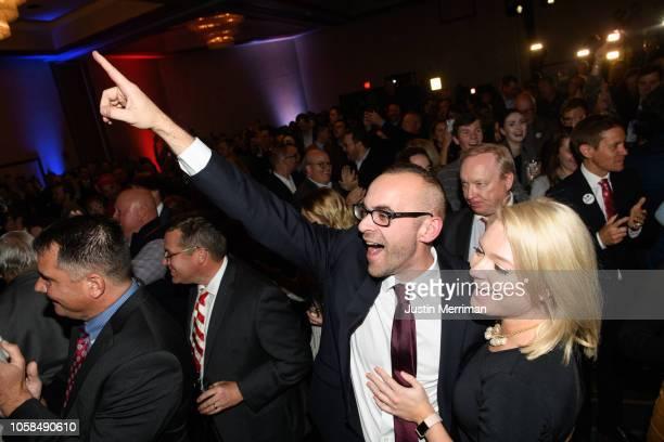 People react as Republican Gubernatorialelect Ohio Attorney General Mike DeWine is declared the winner in the Ohio gubernatorial race at the Ohio...