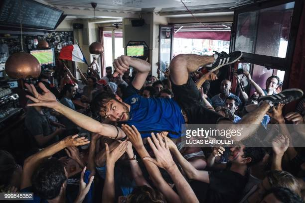 TOPSHOT People react as they gather on July 15 2018 to watch the Russia 2018 World Cup final football match between France and Croatia in the 'Le...