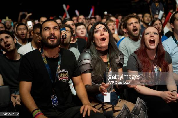 People react as they watch the final of the 'LCS' the first European division of the video game 'League of Legends' between Misfits Gaming and G2...