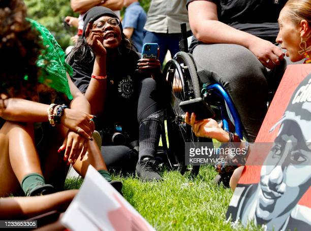 People react as they watch the sentencing hearing of former Minneapolis Police officer Derek Chauvin outside the Hennepin County Government Center on...