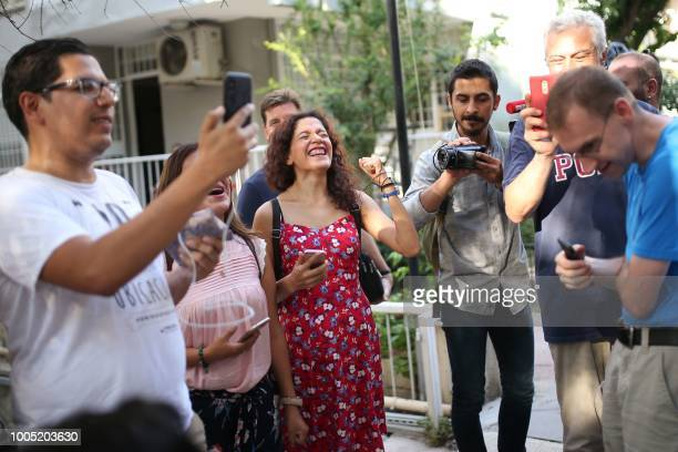 People react as US Pastor Andrew Craig Brunson arrives at his house on July 25 2018 in Izmir Turkey on July 15 2018 moved from jail to house arrest...