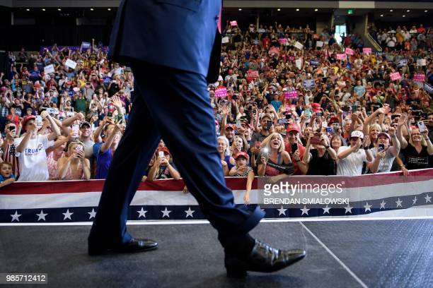 People react as US President Donald Trump arrives for a rally for Rep Kevin Cramer at Scheels Arena on June 27 2018 in Fargo North Dakota