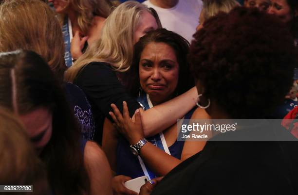 People react as vote results show Democratic candidate Jon Ossoff losing to his challengre during his election night party being held at the Westin...
