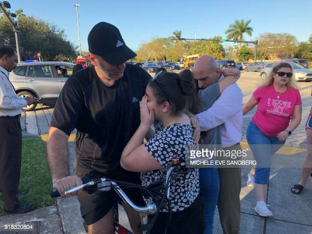 TOPSHOT People react at Marjory Stoneman Douglas High School in Parkland Florida a city about 50 miles north of Miami on February 14 2018 following a...