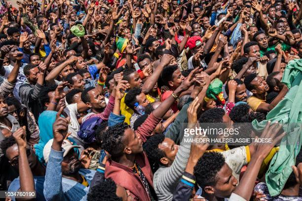 People react at Meskel Square in Addis Ababa Ehiopia to protest on September 17 2018 against the killing of 23 people and displacment of residents in...