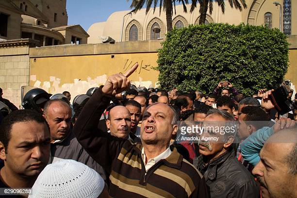 People react at site after an explosion at Saint Mark's Coptic Orthodox Cathedral in Cairo Egypt on December 11 2016