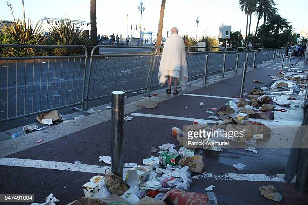 People react at the scene of a terror attack on the Promenade des Anglais on July 15 2016 in Nice France A FrenchTunisian attacker killed 84 people...