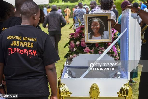 People react beside the coffin of Trufosa Nyaboke who was among those killed during a terror attack at the Dusit hotel complex in Nairobi during her...