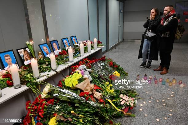 People react by a memorial for the victims of the Ukraine International Airlines Boeing 737800 crash in the Iranian capital Tehran at the Boryspil...