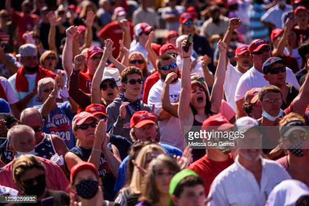 People react during a campaign rally for President Donald Trump on October 24, 2020 in Lumberton, North Carolina. President Trump has expressed his...