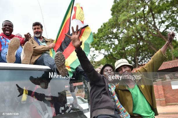 People react during a demonstration marching towards the State House while demanding the resignation of Zimbabwe's president on November 18 2017 in...