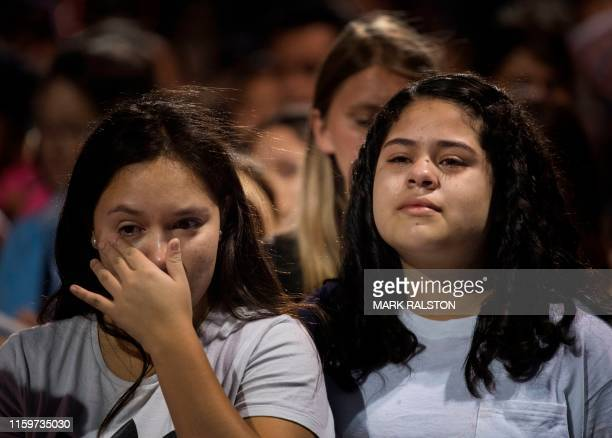 TOPSHOT People react during a prayer and candle vigil organized by the city after a shooting left 20 people dead at the Cielo Vista Mall WalMart in...