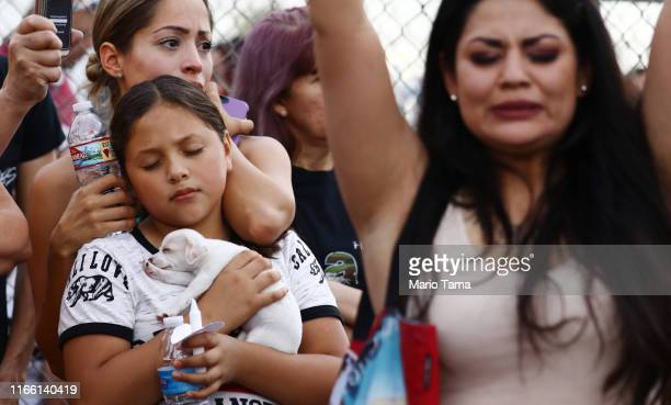 People react during an interfaith vigil for victims of a mass shooting which left at least 20 people dead, on August 4, 2019 in El Paso, Texas. A...