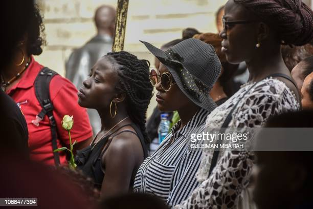 People react during the burial ceremony of Trufosa Nyaboke who was among those killed during a terror attack at the Dusit hotel complex in Nairobi in...