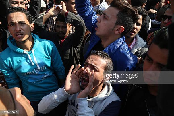 People react during the funeral ceremony for the victims of the explosion at Saint Peter and Saint Paul Coptic Orthodox Church in Abbasiya district...