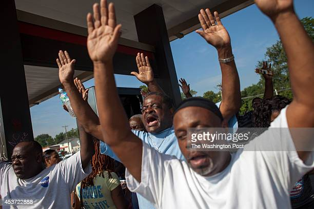 People react following the disclosure by Ferguson Police Chief Thomas Jackson of the name of the Ferguson police officer responsible for the August 9...