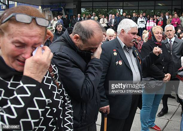 People react in Odessa on May 5, 2014 during the funeral ceremony of Vyacheslav Markin, the deputy of Odessa regional council and a leader of the...