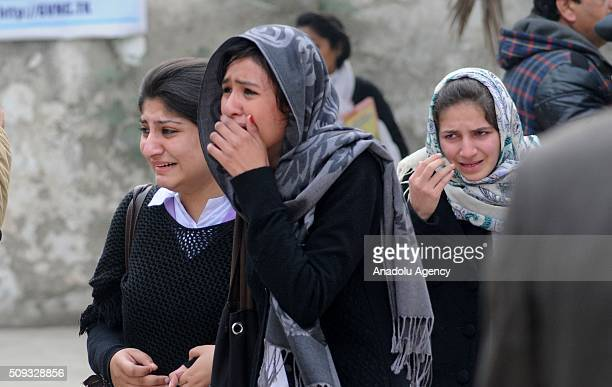 People react near the VaqarunNisa Girls College building after suspects tried to barged into the school following fire exchange between suspects and...