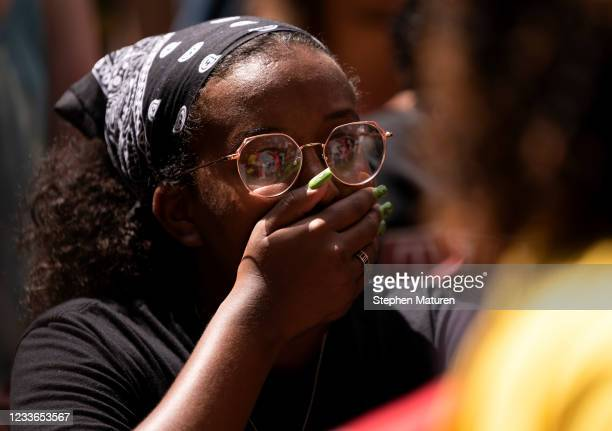 People react outside the Hennepin County Government Center after Judge Peter Cahill announced the sentencing of Derek Chauvin on June 25, 2021 in...