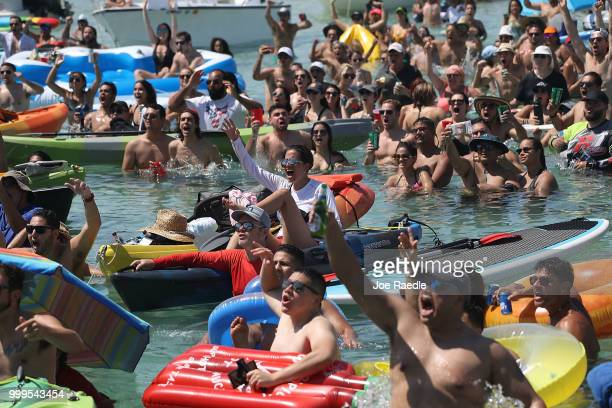 People react to Croatia scoring their 1st goal against France in the World Cup final as it is being broadcast from the Ballyhoo Media boat setup in...