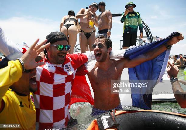 People react to France beating Croatia in the World Cup final as it is being broadcast from the Ballyhoo Media boat setup in the Intracoastal...