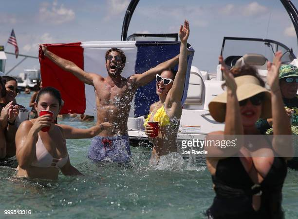 People react to France scoring their 2st goal against Croatia in the World Cup final as it is being broadcast from the Ballyhoo Media boat setup in...