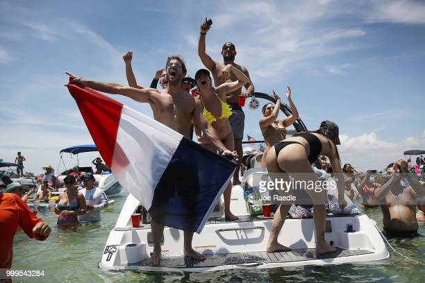 People react to France scoring their 4th goal against Croatia in the World Cup final as it is being broadcast from the Ballyhoo Media boat setup in...