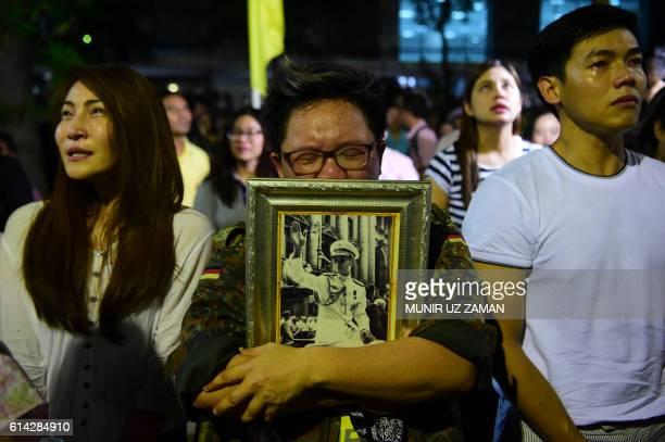 People react to the death of Thailand's King Bhumibol Adulyadej at Siriraj Hospital in Bangkok on October 13 2016 Thailand's King Bhumibol Adulyadej...