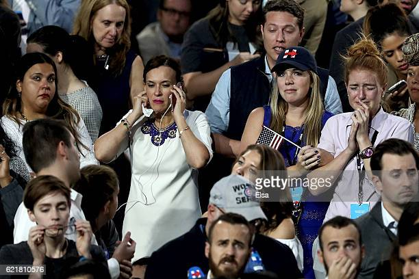 People react to the voting results at Democratic presidential nominee former Secretary of State Hillary Clinton's election night event at the Jacob K...