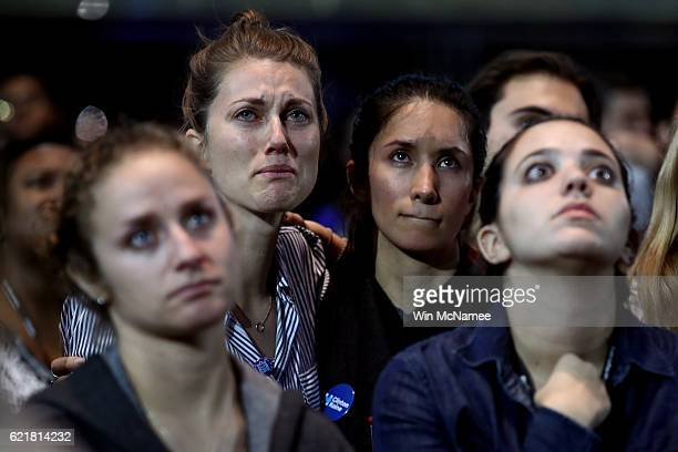People react to the voting results at Democratic presidential nominee former Secretary of State Hillary Clinton's election night event at the Jacob...