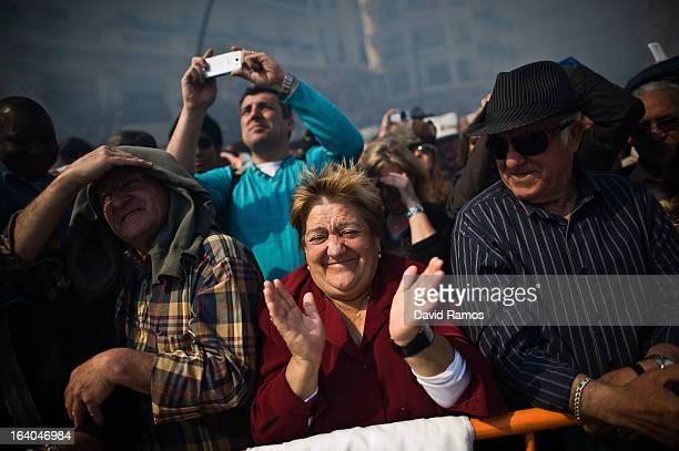 People reacts during the 19th 'Mascleta', an explosive barrage of firecrackers and fireworks celebrating the arrival of the Spring on March 19, 2013...