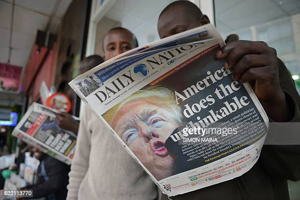 People read a Kenyan daily newspaper with the front page showing newly elected US President Donald Trump in Nairobi on November 10 2016 Donald...