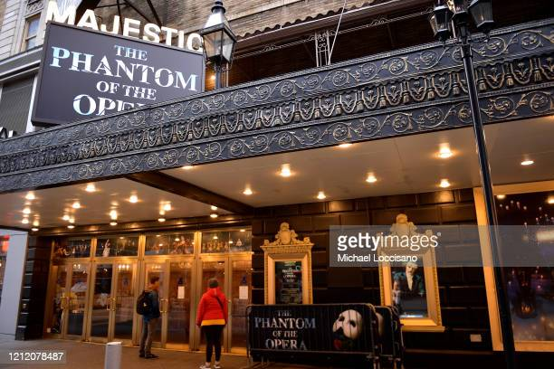 People read a notification at the Majestic Theatre that Broadway productions have been suspended on March 12, 2020 in New York City. As the...