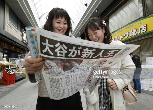 People read an extra newspaper edition in Morioka northeastern Japan on Nov 13 reporting that Shohei Ohtani of the Los Angeles Angels has been named...