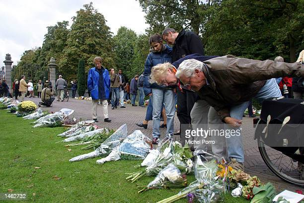 People read cards with flowers outside the royal Palace Huis ten Bosch October 7 2002 in The Hague The Netherlands Prince Claus husband to Queen...