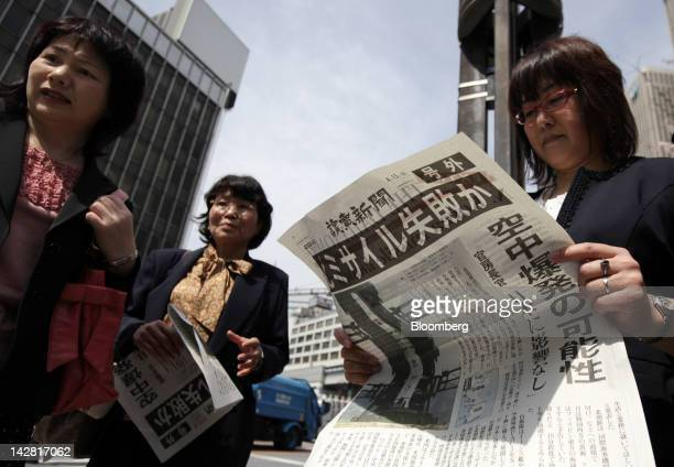 People read copies of an extraedition newspaper reporting the launch of a North Korean rocket in Tokyo Japan on Friday April 13 2012 The North Korean...