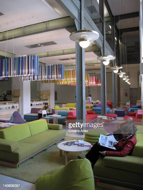 People read in the reading area inside the Palacio de Cibeles Madrid City Council after the restoration carried out since 2007 by the architect...