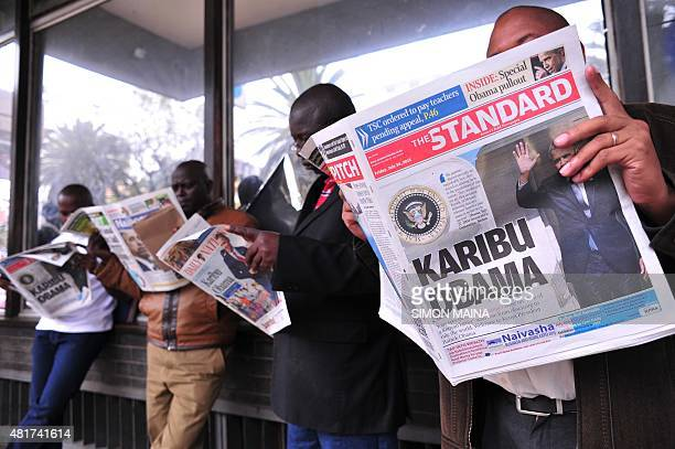 People read local newspapers with pictures of US President Barack Obama on July 24 2015 in Nairobi US President Obama arrives in his ancestral...