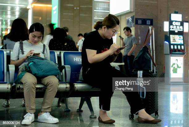 People read on mobile phone while waiting for the train in Tianjin railway station In the first half of 2017 the Chinese users of mobile music video...