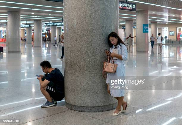 People read on smartphones in metro platform In the first half of 2017 the Chinese users of mobile music video games and reading grew by above 4%