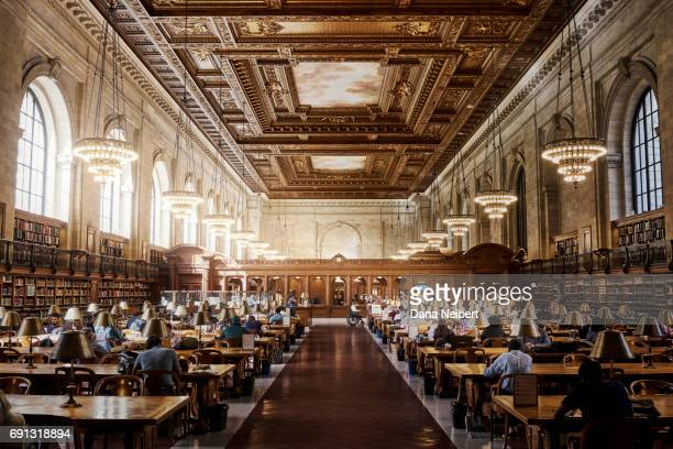 People reading at the New York Public Library