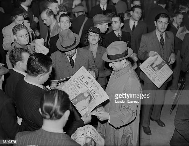 People reading copies of The Daily Express newspaper after the Munich agreement The headline reads 'It Is Peace'