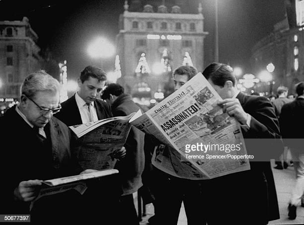 People reading the newspaper in Piccadilly Circle after John F Kennedy's assassination